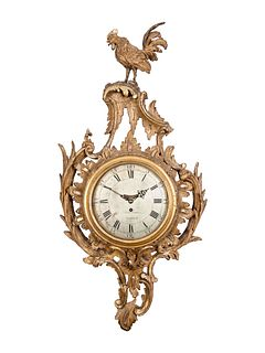 A George II Carved Giltwood Cartel Clock
