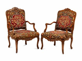 A Pair of Regence Walnut Needlepoint-Upholstered Fauteuils