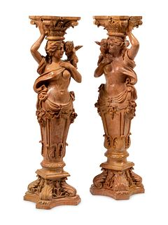 A Pair of Carved Marble Figural Pedestals
