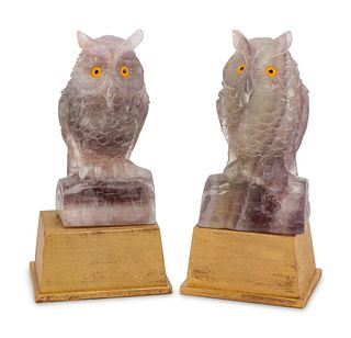 A Pair of Carved Amethyst Owls with Carved Wood Bases