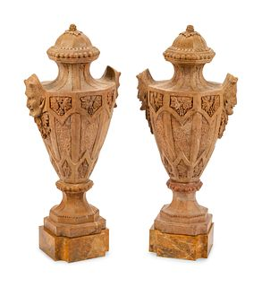 A Pair of Gothic Style Marble Urns with Satyr Handles