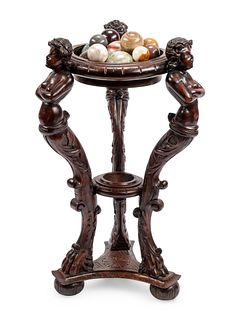 A Continental Carved Wood Jardiniere and Fifteen Marble Ornaments
