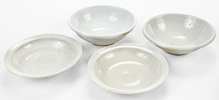 Four Small Chinese Pottery Shallow Bowls