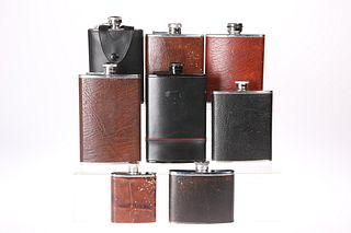 EIGHT VARIOUS HIP FLASKS, all leather covered stainless ste