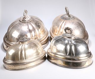 ^ TWO PAIRS OF SILVER-PLATED MEAT COVERS, each pair with en