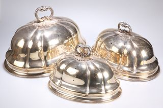 ^ A GRADUATED SET OF THREE SILVER-PLATED MEAT COVERS, of lo