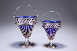 A GRADUATED PAIR OF OLD SHEFFIELD PLATED SWING-HANDLED BASK