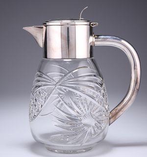 A LARGE SILVER PLATE MOUNTED CUT GLASS LEMONADE JUG, early