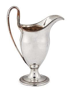 AN OLD SHEFFIELD PLATED CREAM JUG, of helmet form with reed