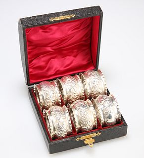 A SET OF SIX LATE VICTORIAN SILVER NAPKIN RINGS,by William