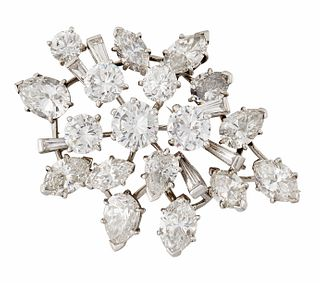 A DIAMOND BROOCH, BY CARTIER, set throughout with round bri