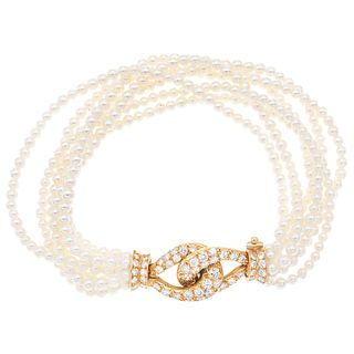 BRACELET WITH CULTIVATED PEARLS AND DIAMONDS IN 18K YELLOW GOLD, Clasp with pressure safety
