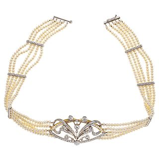 14K WHITE AND YELLOW GOLD NECKLACE WITH CULTIVATED PEARLS AND DIAMONDS Sliding tube clasp with eight shape safety