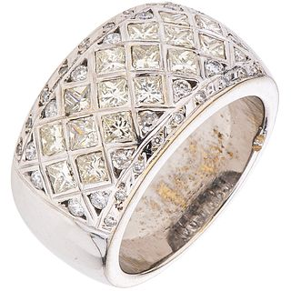 RING WITH DIAMONDS IN 18K WHITE GOLD Weight: 18.6 g. Size: 8 ¼ 16 Princess cut diamonds ~ 1.60 ct 34 Dia ...