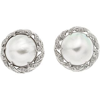 "PAIR OF EARRINGS WITH HALF PEARLS AND DIAMONDS IN PALLADIUM SILVER Weight: 18.0 g. Diameter: 0.86"" (2.2 cm)"