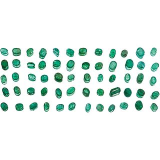 UNMOUNTED EMERALDS 2 Emerald cut emeralds (one slightly chipped), 57 faceted oval cut, 1 round cut fac ...