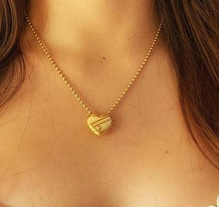 Tiffany & Co. 18K Gold cupid Heart arrow Pendant Necklace