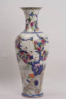 A Famille Rose Peach and Figure Porcelain Vase