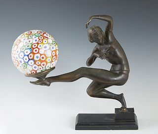 Art Deco Patinated Spelter Figural Lamp, 20th c., in the manner of Gerda Gerdago (1906-2004), of a dancer balancing a millefiore ball shade lamp on he