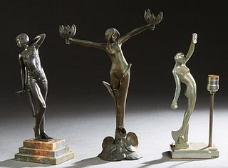 Group of Three Spelter Figures, 20th c., consisting of an art nouveau patinated figural lamp, with a lilypad base; a deco style metal dancer on a step