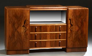 English Carved Walnut Art Deco Sideboard, c. 1940, the raised center section with two sliding glass doors, over a bank of three drawers, flanked by lo
