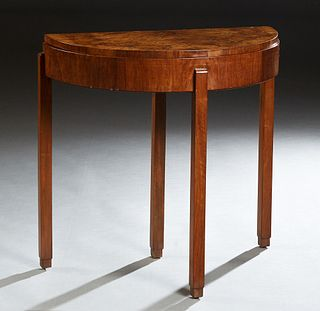English Art Deco Carved Walnut Demilune Table, c. 1940, the highly figured top over a wide skirt with a rear drawer, on rectangular legs, H.- 30 in.,