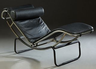 Corbusier Style Mid Century Modern Recliner, 20th c., with black leather covering on a chrome frame over an ebonized iron base, H.- 34 in., W.- 62 in.