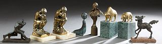 "Group of Eight Cabinet Figures, 19th and 20th c., consisting of a gilt iron art nouveau bust; a pair of brass bull marble bookends; a pair of ""Thinker"