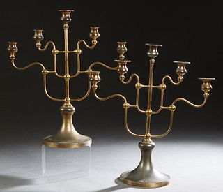 Unusual Pair of Brass Five Light Candelabra, 20th c, stamped E1635 on the underside, with a central straight candle arm, flanked by four curved candle