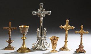 Six Religious Items, 20th c., consisting of four table crucifixes, a diminutive altar vase, and a brass communion chalice, Largest Crucifix- H.- 13 3/
