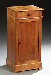French Louis Philippe Carved Cherry Nightstand, 19th c., the rectangular top over a frieze drawer and a cupboard door, on a plinth base on block feet,