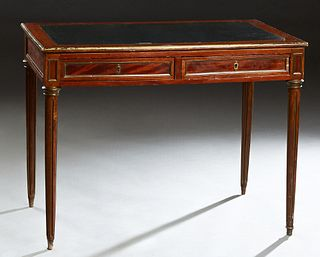 French Louis XVI Style Carved Mahogany Ormolu Mounted Writing Table, early 20th c., the inset leather top with an ormolu banding over two frieze drawe