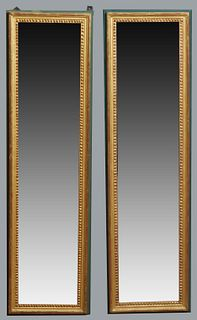 Pair of Tall Louis XVI Style Gilt Mirrors, 20th c., the beaded frames, mounted on polychromed backing boards, H.- 51 in., W.- 13 3/4 in., D.- 1 1/4 in
