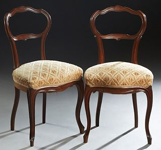 Pair of French Louis XV Style Carved Walnut Side Chairs, late 19th c., the open oval back over a cushioned bowed seat, on cabriole legs, in green, whi