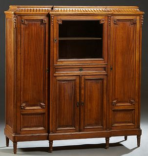 French Carved Oak Louis XVI Style Sideboard, early 20th c., the stepped sloping reeded breakfront top over a center glazed door above a frieze drawer