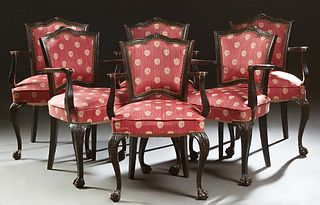 Set of Six Louis XV Style Ebonized Carved Beech Armchairs, 20th c., the serpentine canted cushioned shield back over a cushioned seat flanked by curve