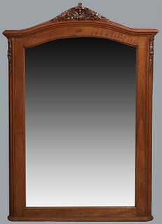French Louis XVI Style Carved Mahogany Overmantle Mirror, early 20th c., the arched shell and floral carved stepped crown over an arched wide beveled