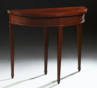 French Carved Mahogany Louis XVI Style Demilune Games Table, 20th c., on tapered square legs, H.- 29 1/2 in., W.- 35 in., D.- Closed- 17 1/2 in., Open