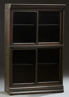 Unusual Carved Oak Barrister's Bookcase, c. 1910, the stepped top over two stacking sections with sliding glass doors, on a rounded stepped base, H.-