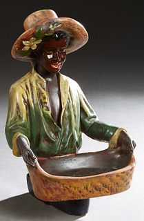 African American Figural Polychromed Ceramic Calling Card Tray, 20th c., H.- 15 in., W.- 9 1/2 in., D.- 11 in.