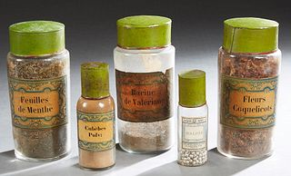 Set of Five French Glass Apothecary Bottles, 19th c., with paper labels and green tin lids, Three- H.- 9 3/8 in., Dia.- 4 in; 1- H.- 7 in., Dia.- 2 1/