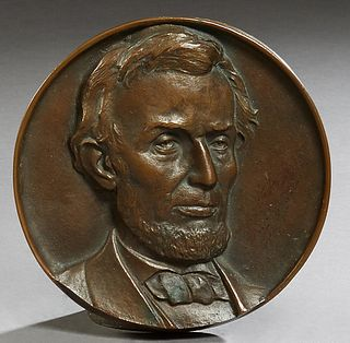 """""""Abraham Lincoln,"""" 19th c., patinated bronze relief plaque, H.- 1 in., Dia.- 7 in."""