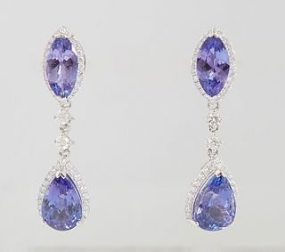 Pair of Platinum Pendant Earrings, the stud with a marquise tanzanite atop a border of round diamonds suspending a pear shaped tanzanite atop a border