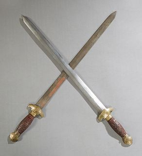 Unusual Wood, Brass and Steel Double Sword, 20th c., in a brass mounted faux tortoise scabbard, H.- 28 1/4 in., W.- 3 in., Dia.- 1 1/4 in.