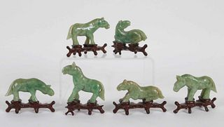 Six Carved Jade Horses on Stands
