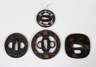 Four Japanese Bronze and Iron Tsuba