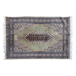 Tapete. Siglo XX. Estilo Tabriz. Elaborado en fibras de lana y algodón. Decorado con motivos florales, geométricos, orgánicos.