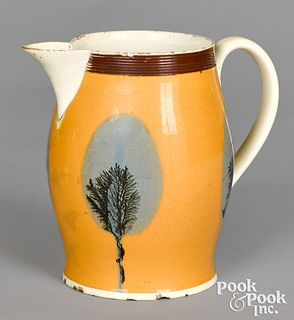 Mocha pitcher with seaweed over fan decoration