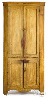 Pennsylvania painted one-piece corner cupboard