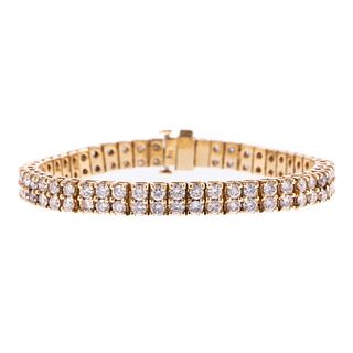 A 12.50 ct Diamond Line Bracelet in 14K Gold